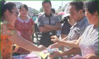 托托乡计生协开展世界人口日宣传服务活动
