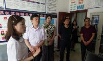 重庆市计生协专职副会长唐光义到潼南调研基层计生协组织规范化建设